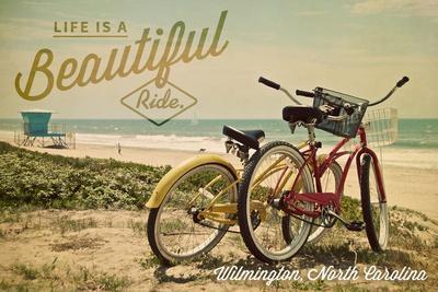 https://imgc.artprintimages.com/img/print/wilmington-north-carolina-life-is-a-beautiful-ride-beach-cruisers_u-l-q1grdcb0.jpg?p=0