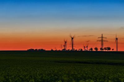 Wind Turbines in a Rapeseed Flower Field-Babak Tafreshi-Photographic Print