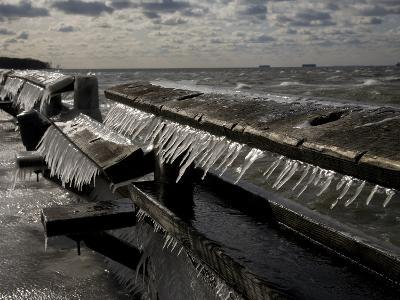 Windblown Icicles Coat a Pier on a Chesapeake Bay Winter Day-Stephen St^ John-Photographic Print