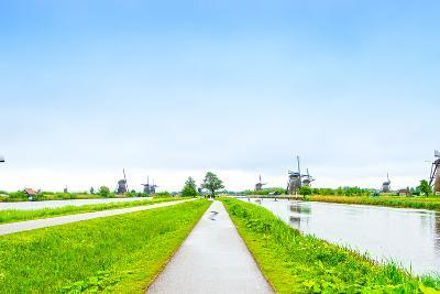 Windmills and Canals in Kinderdijk, Holland or Netherlands. Unesco Site-stevanzz-Photographic Print