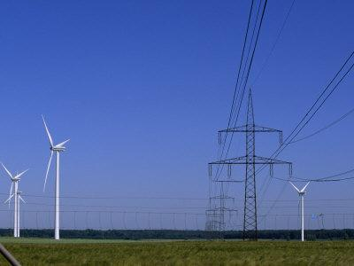 https://imgc.artprintimages.com/img/print/windmills-and-high-voltage-transmission-lines-in-a-clear-blue-sky-mecklenburg-vorpommern-germany_u-l-p6ftgx0.jpg?p=0