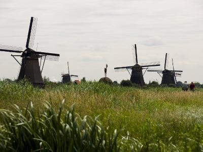 Windmills in a Field in the Netherlands-Mattias Klum-Photographic Print