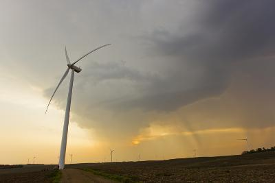 Windmills or Turbines That Produce Kinetic Energy Lined Up on Farms-Mike Theiss-Photographic Print