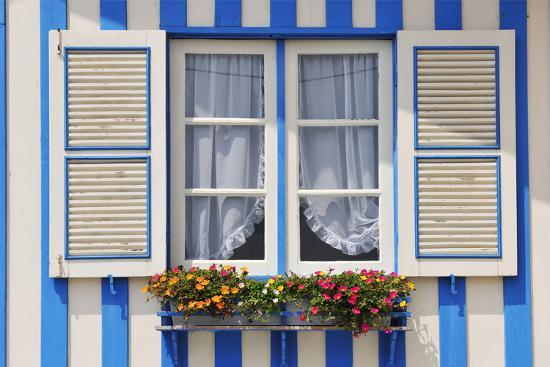 Window of a Traditional Striped Painted House in the Little Seaside Village of Costa Nova, Portugal-Mauricio Abreu-Photographic Print