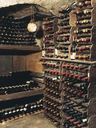 https://imgc.artprintimages.com/img/print/wine-bottles-on-a-rack-in-a-wine-cellar_u-l-q10bjvh0.jpg?p=0