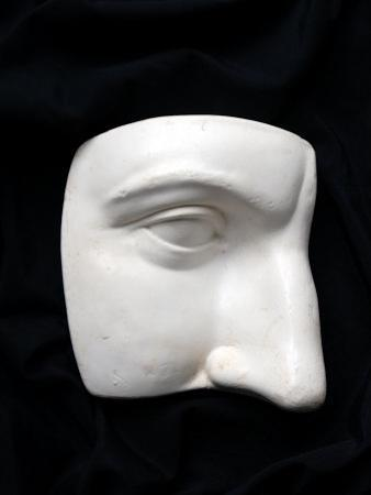 A Cut Out of a Sculpture Including a Man's Face