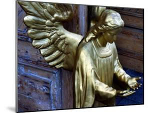 Golden Angel at Doors by Winfred Evers