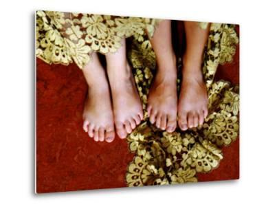 Two Pair of Feet of Small Children with Textile Spread around Them