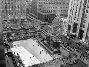 With the Famed Rockefeller Center Christmas Tree Rising Above Them, Skaters Glide on the Ice