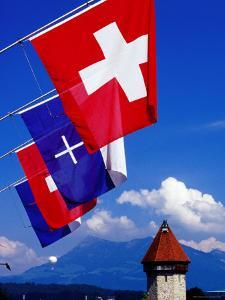 Canton Flags with Balloon in Distance at Kapellbrucke, Lucerne, Lucerne, Switzerland by Witold Skrypczak