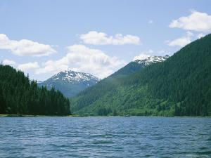 Snow-Dappled Mountains, Evergreen Trees, and a Calm Waters by Wolcott Henry