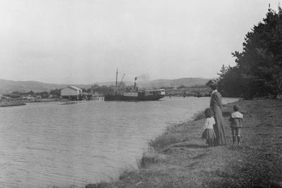 Woman and Children Watching a Ship at Waipu Wharf, C.1900--Photographic Print