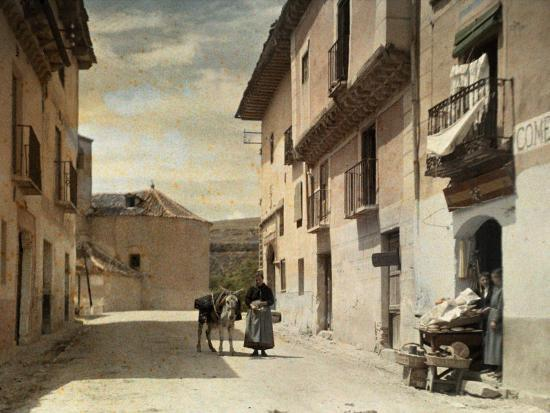 Woman and Donkey Stand in an Empty Street in Segovia-Gervais Courtellemont-Photographic Print