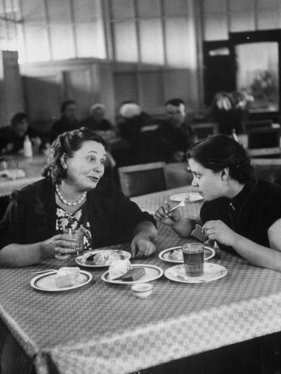 Woman and Her Daughter Eating in a Restaurant-Lisa Larsen-Photographic Print
