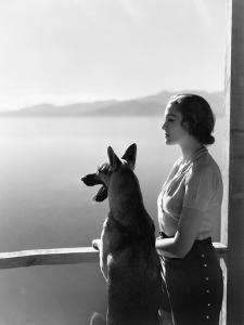 Woman and Her German Shepherd Overlooking a Lake