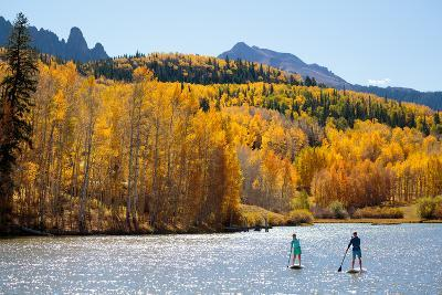 Woman And Man Enjoy Fall Bliss On SUP Boards Near Telluride, Colorado In Autumn, San Juan Mts-Ben Herndon-Photographic Print