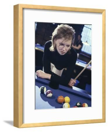 Woman at a Pool Table