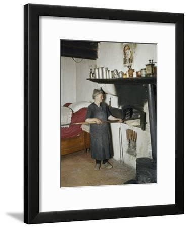 Woman Bakes Bread in Her One Room House-Howell Walker-Framed Photographic Print