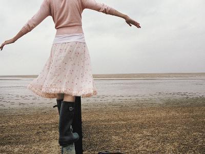 Woman Balancing on a Breakwater--Photographic Print