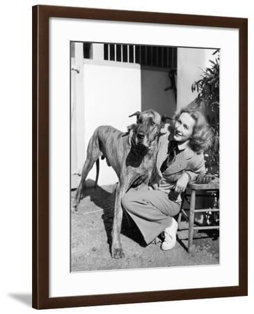 Woman Bending Next to Her Great Dane to Give Him a Hug--Framed Photo