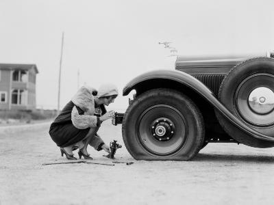 Woman Changing Flat Tire on Car-H^ Armstrong Roberts-Photographic Print