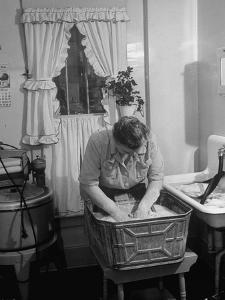 Woman Doing Laundry by Hand after Washing Machine Broke Down