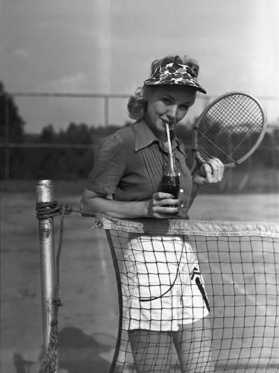 Woman Drinking Cola at Tennis Net-George Marks-Photographic Print