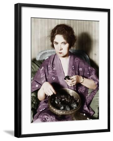 Woman Eating Chocolates Out of a Bowl--Framed Photo