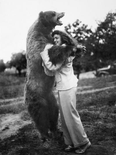 Woman Embraces a Stuffed Bear, Ca. 1940--Photographic Print