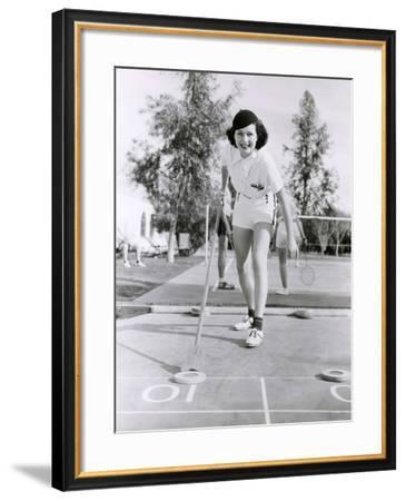 Woman Enjoying a Game of Shuffleboard--Framed Photo