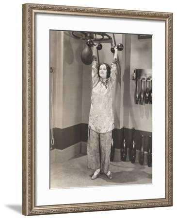 Woman Exercising in Silk Pajamas--Framed Photo