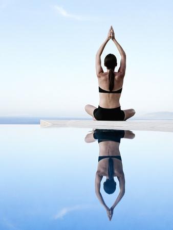 https://imgc.artprintimages.com/img/print/woman-exercising-on-swimming-pool-edge_u-l-pzll7d0.jpg?p=0