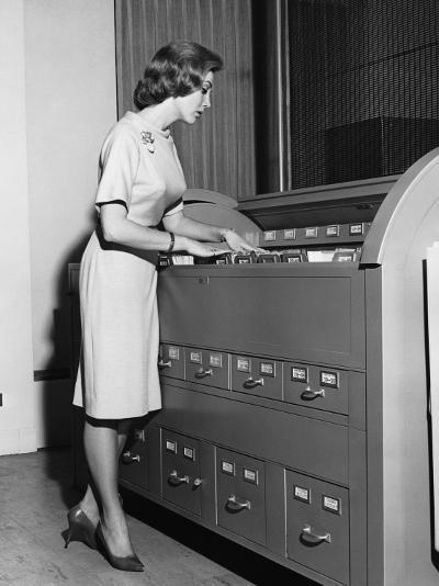 Woman Filing--Photographic Print