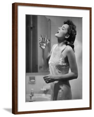 Woman Gargling Water at Bathrom Sink-George Marks-Framed Photographic Print