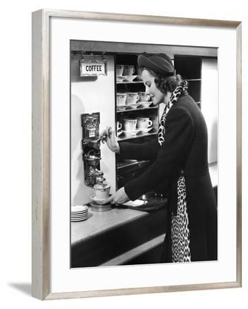 Woman Getting Coffee at Old Fashioned Machine-George Marks-Framed Photographic Print