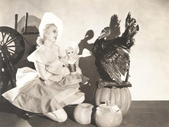 Woman Holding Doll Wearing Identical Thanksgiving Costume--Photo