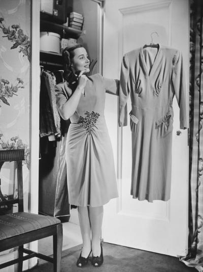 Woman Holding Dress at Opened Doors of Dressing-Room-George Marks-Photographic Print