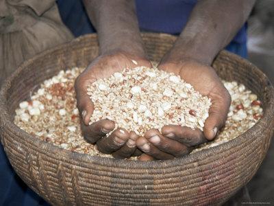 https://imgc.artprintimages.com/img/print/woman-holding-handfuls-of-grain-soddo-ethiopia-africa_u-l-p1tnwx0.jpg?p=0