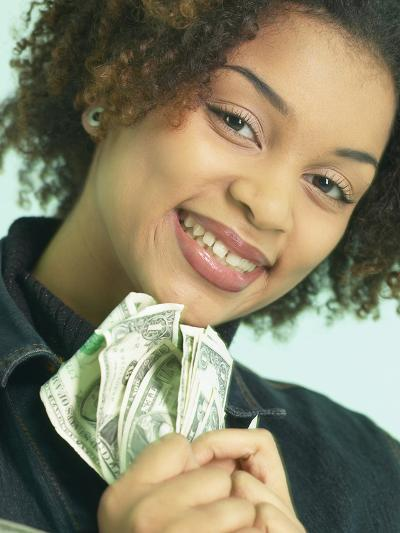 Woman Holding Money--Photographic Print