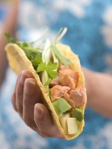 Woman Holding Taco