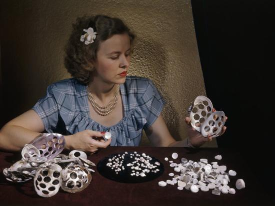 Woman Holds Mussel Shells and Pearl Buttons Made from Those Shells-Willard Culver-Photographic Print
