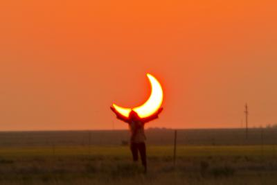 Woman Holds Up Arms as If She Is Holding Up the Annular Solar Eclipse-Mike Theiss-Photographic Print