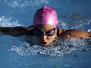 Woman in Action During a Butterfly Swimming Race