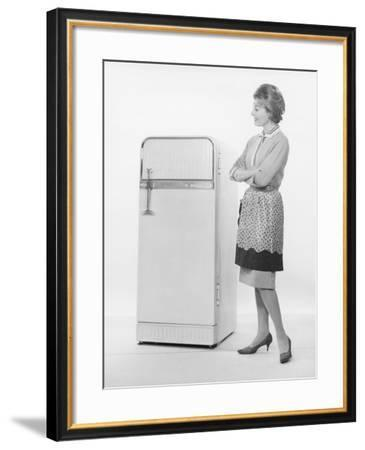 Woman in Apron Looking at Refrigerator-George Marks-Framed Photographic Print