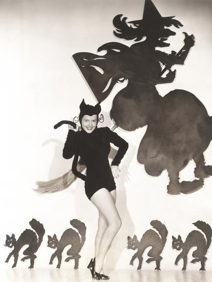 Woman in Cat Costume Posing Against Halloween Themed Wall--Photo