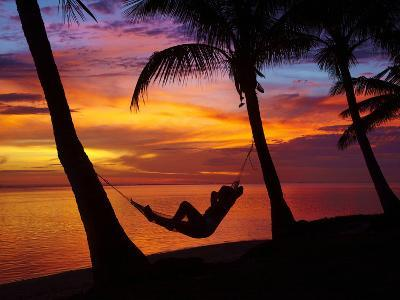 Woman in Hammock, and Palm Trees at Sunset, Coral Coast, Viti Levu, Fiji, South Pacific-David Wall-Photographic Print