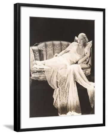Woman in Lace Gown Lounging on Sofa--Framed Photo