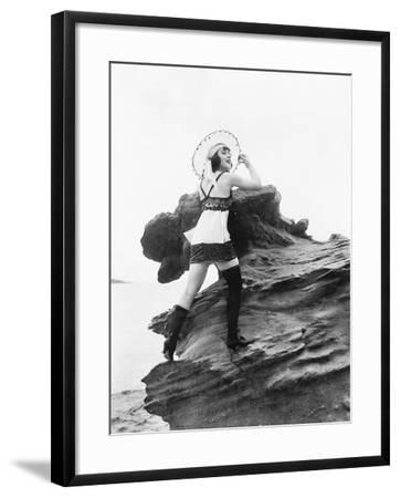 Woman in Lingerie Leaning on a Rock Next to Water--Framed Photo