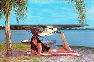 Woman in Silver Suit by Seaplane