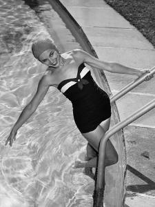 Woman in Swimming Pool Posing on Steps
